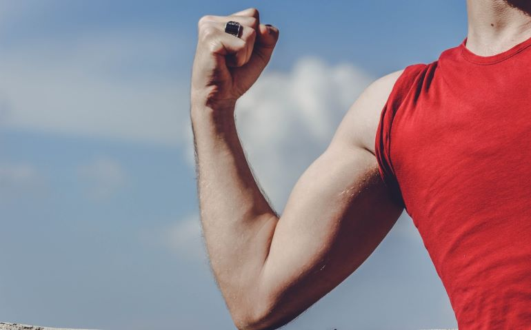A guy showing his biceps.