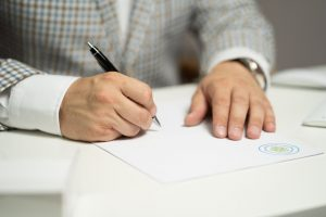 A man signing a contract,
