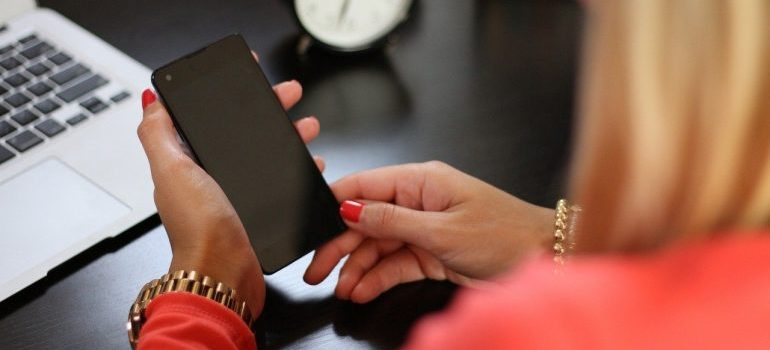 A woman holding a phone.
