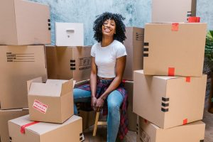 a girl surrounded by boxes