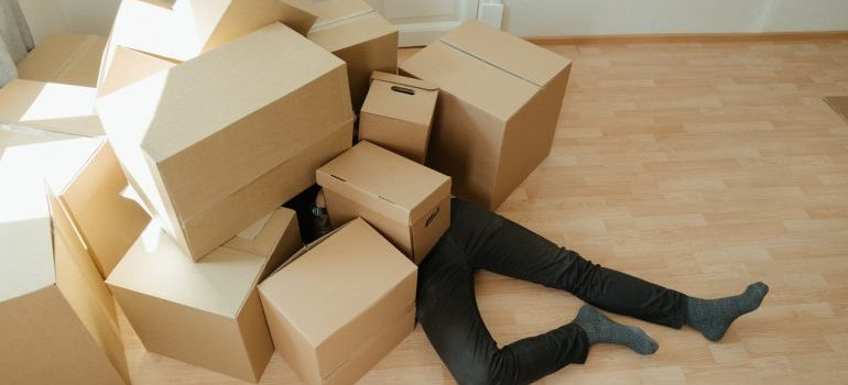 Man covered in boxes