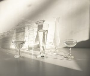 several types of glassware in the sun