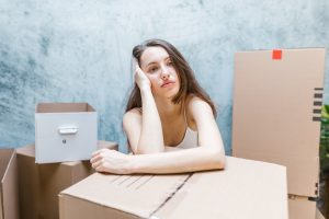 Woman worrying about risks of hiring cheap movers