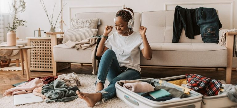 a girl listening to music as she packs